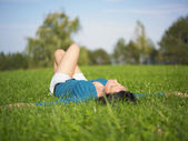 Woman Lie on grass — Stock fotografie
