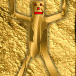 Stock Photo: Goldenpuppet in golden surrounding