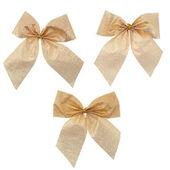 Three gift gold ribbon and bow — Stock Photo