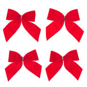 Four gift red ribbon and bow — Stock Photo