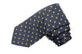 Yellow diamond pattern shappes blue tie — Stock Photo