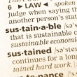 The word sustainable  in the old dictionary - Stock Photo
