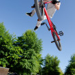 BMX Bike Stunt tail whip - Stock Photo