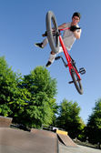 BMX Bike Stunt tail whip — Stock Photo