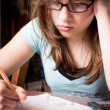 Stock Photo: Stressed Teen Doing Homework