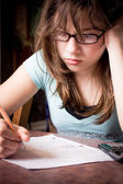 Stressed Teen Doing Homework — Stock Photo