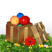 Easter eggs in a golden package — Stock Photo