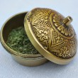 Brass box with dried grass - Stock Photo