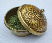 Brass box with dried grass — Stock Photo