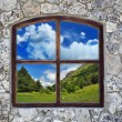Stock Photo: Stone wall with a window