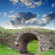 Ruins of an ancient arch - Stock Photo
