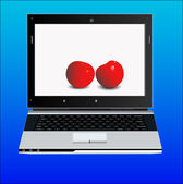 Appetizing ripe cherries in the laptop — Stock Photo