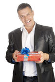 The happy smiling man with a celebratory gift — Stock Photo