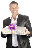 The happy smiling man on a white background with a celebratory gift — Stock Photo