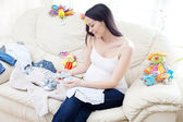 Happy pregnant caucasian brunette woman — Stock Photo