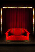 Red sofa on the stage — Stock Photo