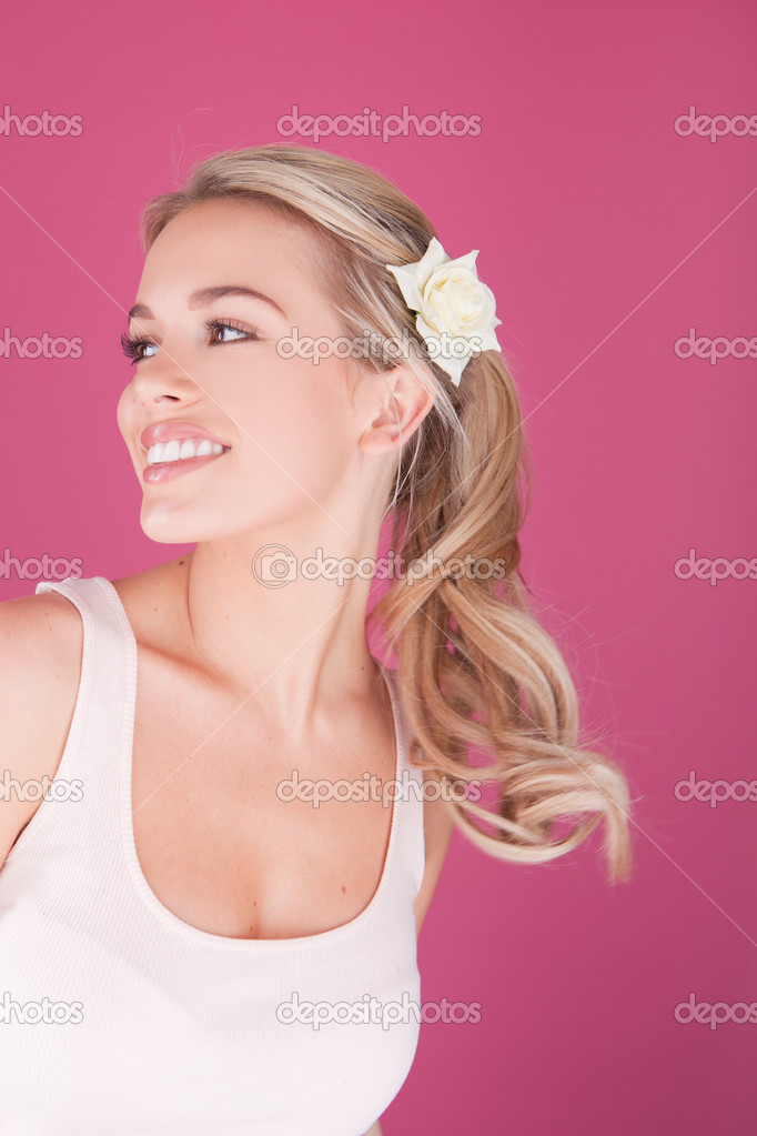 Beauty woman face on pink background — Stock Photo #5963487