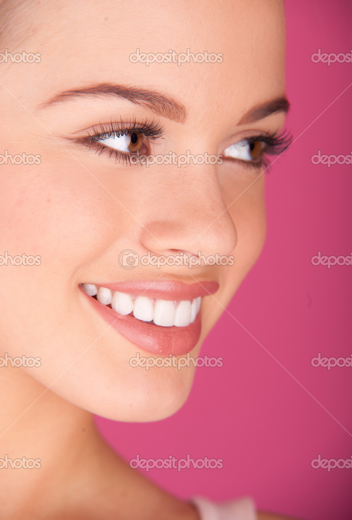 Beautiful young woman. perfect teeth smiling — Stock Photo #5963511