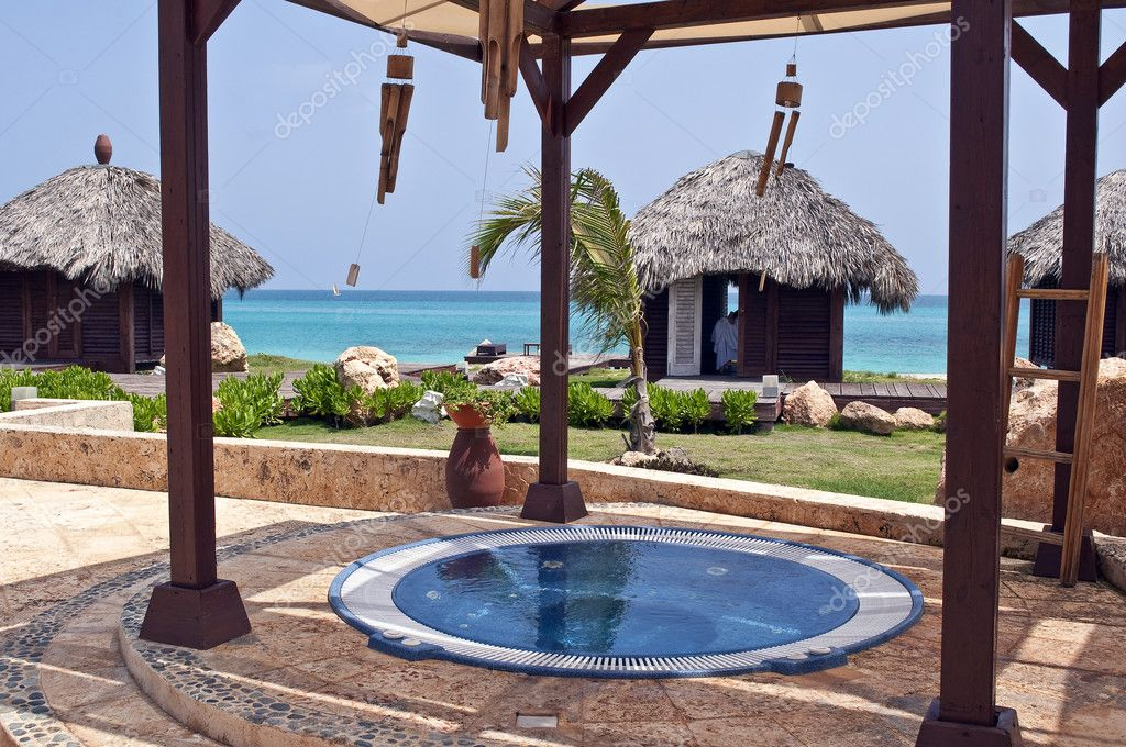 Spa in the Caribbean, jacuzzi and massage huts. — Stock Photo #6326844