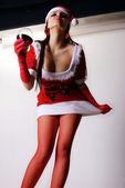 The girl in Christmas clothes — Stock Photo