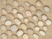 Stones on a wool fabric. — Stock Photo