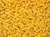 Dry pasta spirales. — Stock Photo