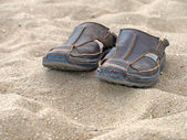 Shoes on sand. — Stock Photo