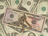 Metal keys on a dollar banknotes. — Stock Photo