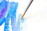 Watercolor brush with blue paint — Stock Photo