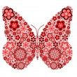 Butterfly made from many various flowers — Stock Photo
