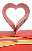 Opened book and heart shape — Stockfoto