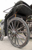 Wooden wheel of antiquarian carriage — Photo
