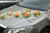 Car with decorations from flower for driving bride and groom — Stock Photo