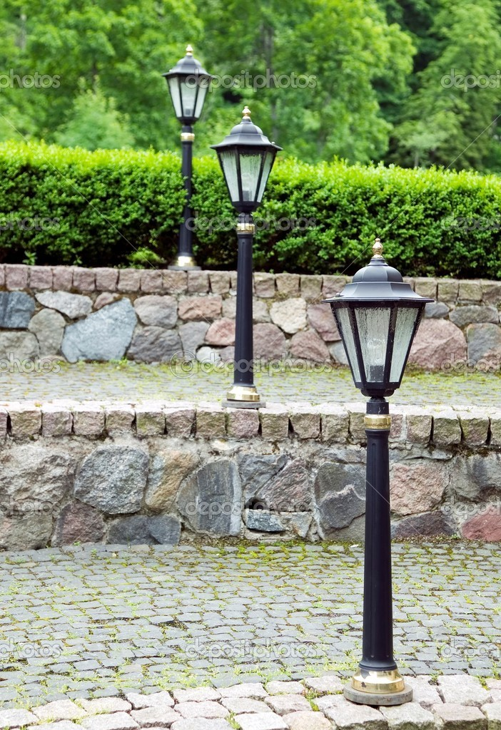 Metal old style lamp with grunge brick background — Stock Photo #6282791