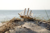 Miniature ship standing on sand — Stock Photo