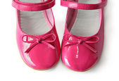 Patent leather shoes with bows on a white background — Stock Photo