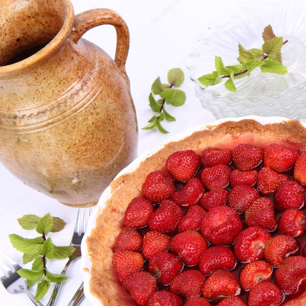 Strawberry Tart, plates, a pot, forks, strawberries and mint twigs on a white background   Stock Photo #6039928