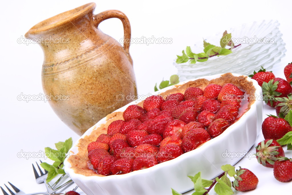 Strawberry Tart, plates, a pot, forks, strawberries and mint twigs on a white background  — Stock Photo #6040786