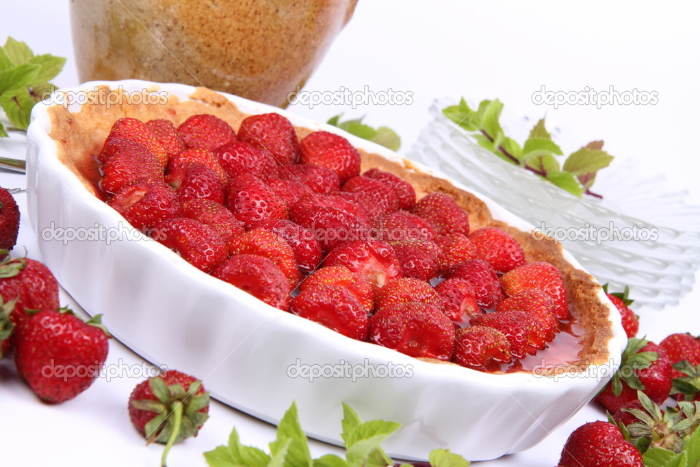 Strawberry Tart, plates, a pot, forks, strawberries and mint twigs on a white background  — Stock Photo #6040836