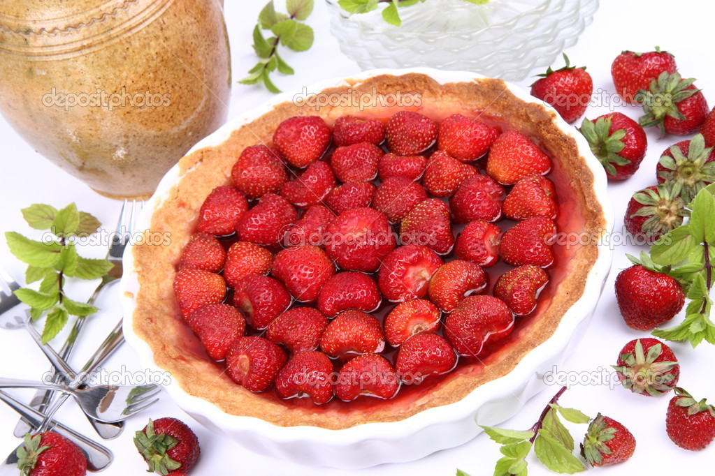 Strawberry Tart, plates, a pot, forks, strawberries and mint twigs on a white background  — Stock Photo #6041089