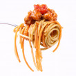 Spaghetti bolognese on a fork — Stock Photo #6701299
