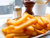 Złoty frytki ziemniaki — Zdjęcie stockowe