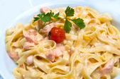 Pasta and smoked salmon — Stock Photo