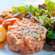 Fresh salmon salad with tomatoes — Stock Photo