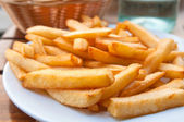 Golden French fries potatoes — Stock Photo