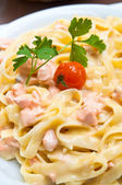 Tasty pasta with salmon — Stockfoto