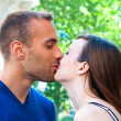 Portrait of Young kissing couple — Stock Photo