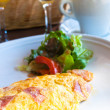 Omelet with ham tomato - Stock Photo