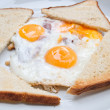 Fried egg with bacon and toasts — Stock Photo
