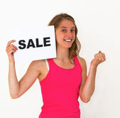 Young woman with board sale — Stock Photo